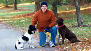 man-middle-age-dogs-woods-1col.jpg