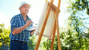 senior_man_painting_easel-1col.jpg