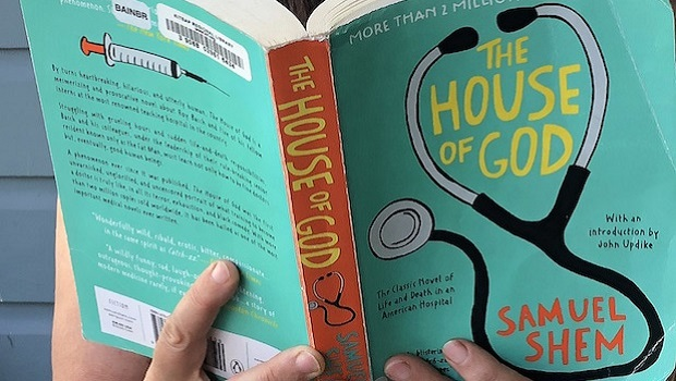 Woman reading the novel House of God.