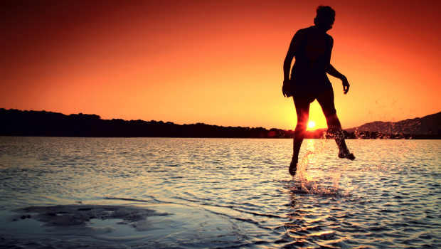 girl-skipping-water-sunset_620x350.jpg