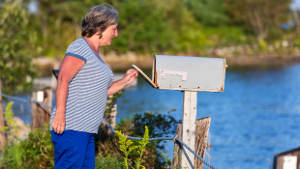 senior-woman-mailbox-lake-1col.jpg